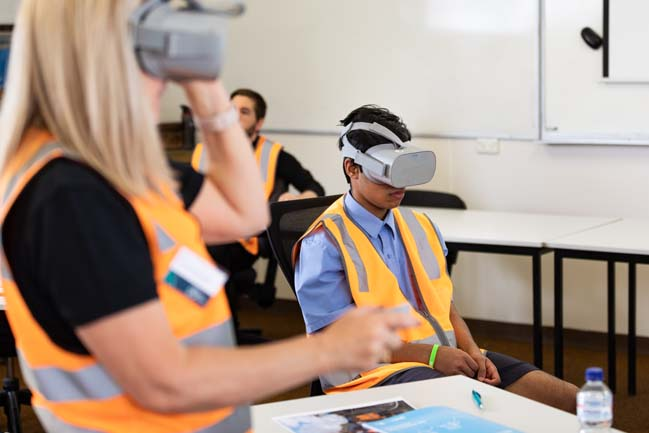 Students wearing virtual reality goggles during the rail careers event in April