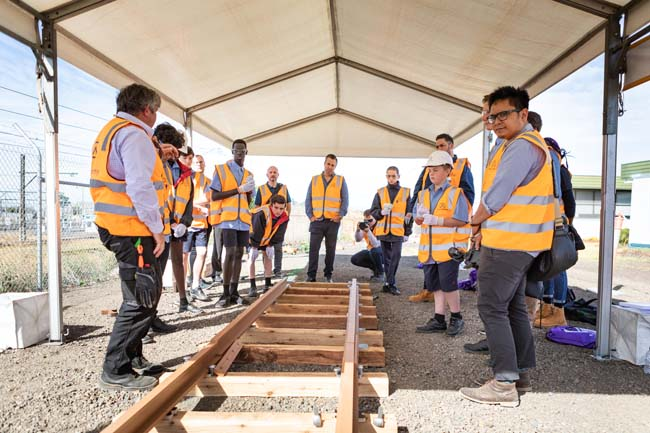 Students gathering around test rail track at the Rail Academy Newport for the rail careers event in April