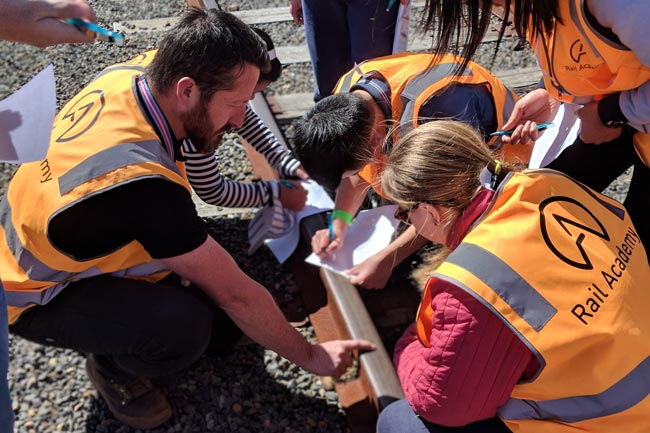 Students inspecting track at the latest Rail Careers Day